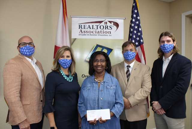 Mollie Cunningham accepts a campaign donation from the Lake County Realtors Association