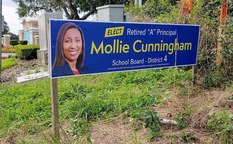 Mollie Cunningham for Lake County School Board Dist 4 campaign sign, which reads 'Elect retired A principal Mollie Cunningham School Board District 4'