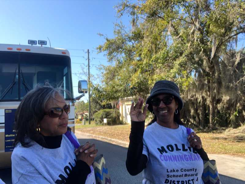 Mollie Cunningham waving at supporters at the George Washington State Parade in Eustis